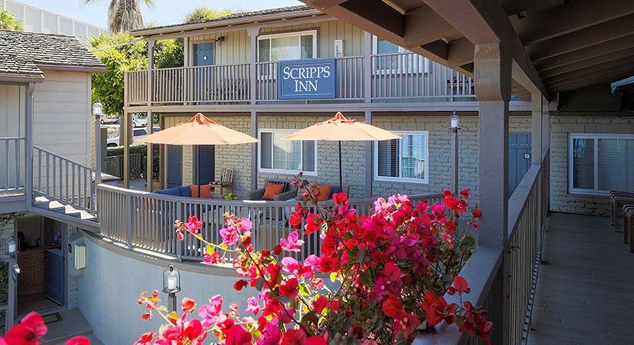 Scripps Inn Deck with orange umbrellas and red flowers