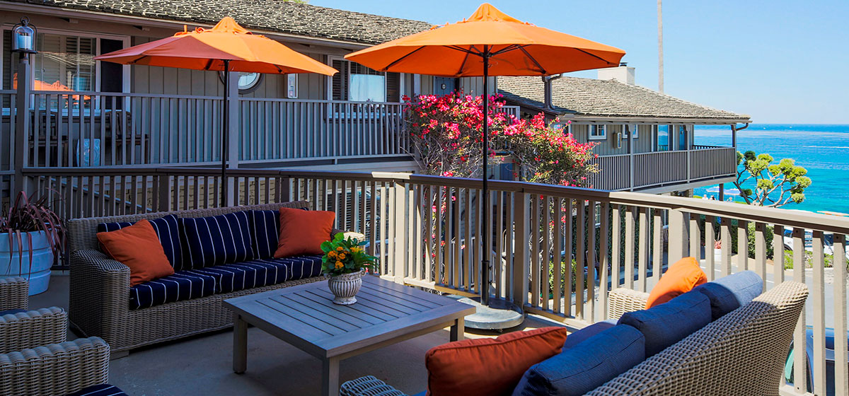Scripps Inn Patio Seating with Orange Pillows and Ocean Views