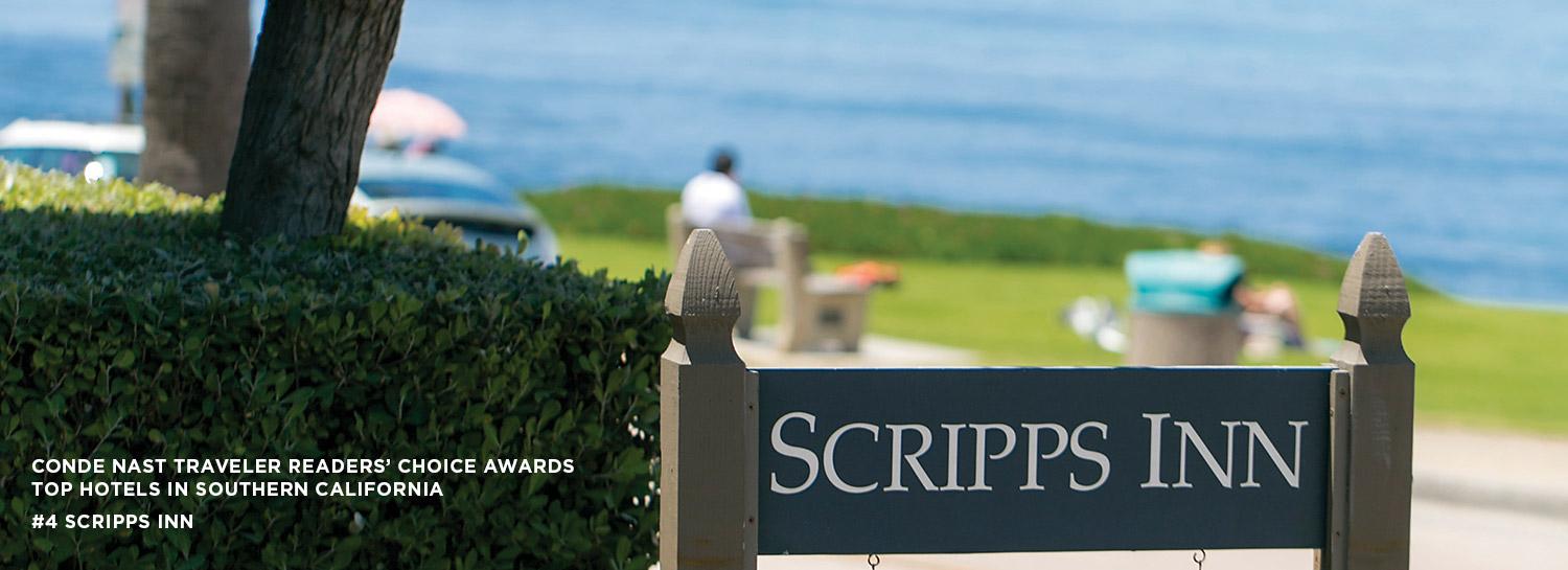 Scripps Inn Sign with park and ocean in the background